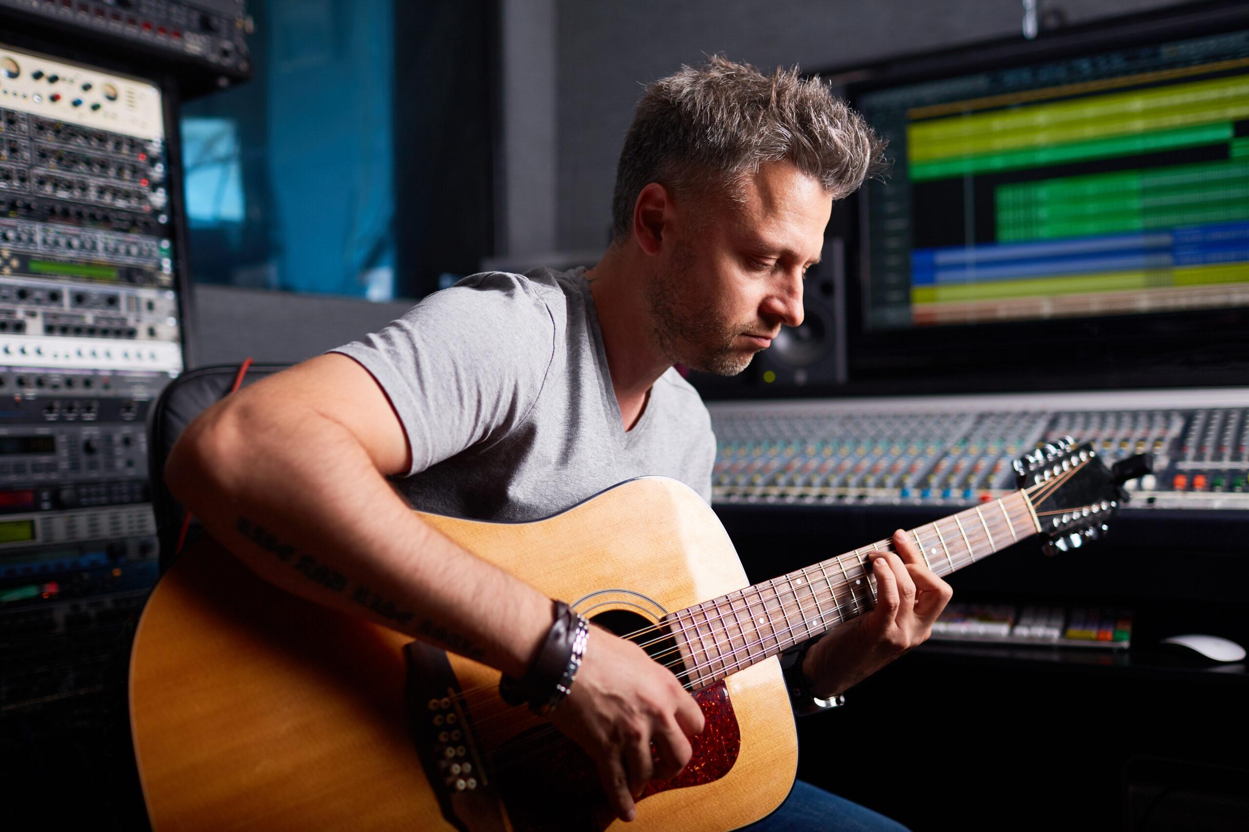 musician sitting in the studio